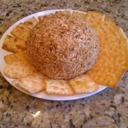 Cheese Ball I Recipe - A buffet of dried herbs, plus Worcestershire, mayonnaise, garlic, and more are rolled up into one great ball of fire!