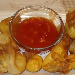 Sweet and Sour Sauce II Recipe - This simple sweet and sour sauce is delicious with egg rolls, spring rolls and other Asian-inspired delicacies. The pineapple tidbits may be omitted. Alter the amount of cornstarch as needed to obtain desired consistency.