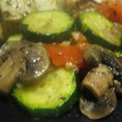 Zucchini Saute Recipe - Zucchini is sauteed with red onion, mushrooms, tomato and herbs.  You can use any veggies you like.  Serve over pasta, if desired.