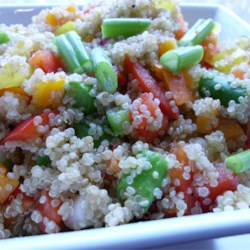 Quinoa Vegetable Salad Recipe - Quinoa is combined with yellow bell pepper, diced red onion, and fresh mint in this colorful salad.