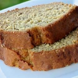 Granny's Banana Bread Recipe - Very moist banana bread containing applesauce and spiced with cinnamon and nutmeg. Raisins and walnuts are optional.