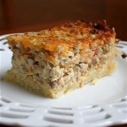 Sausage Casserole Recipe - Simply delicious! Fresh shredded potatoes and onions make the difference in this breakfast casserole.