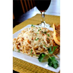 Creamy Linguine with Clam Sauce Recipe - White clam sauce is even easier when you use store-bought Alfredo sauce. Extra garlic and onion gives it a great homemade taste.