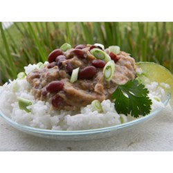 Restaurant Style Red Beans and Rice Recipe - Believe it or not the secret to many bean dishes is lard.  Red beans are simmered, slowly, with ham hock.  Then the beans and meat are processed in a food processor with spices and lard.  The beans are reheated and served over rice.