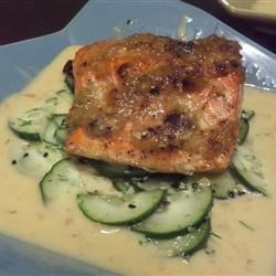 Ginger-Scallion Crusted Salmon Recipe - Fresh salmon fillets are seared with ginger and garlic, topped with a white wine ponzu sauce, and served on a sesame-dill cucumber salad in this flavorful Japanese-influenced recipe.