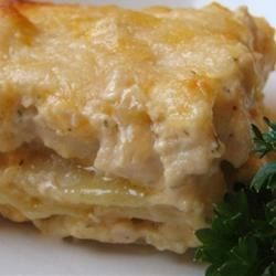 Chicken Lasagna II Recipe - A savory saute of ground chicken or turkey with onions and green peppers is blended with cream of mushroom soup and cream of chicken soup, then layered with noodles and cheeses to make a tasty lasagna.
