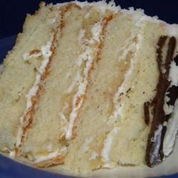 Heavenly White Cake Recipe and Video - Cake flour, butter, egg whites, and milk are mixed with vanilla and almond extracts in this classic white cake recipe.