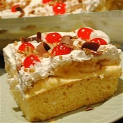 Banana Split Cake III Recipe - Your favorite banana split ingredients on a cake base. A summer treat. decorate with cherries and your favorite chopped nuts.