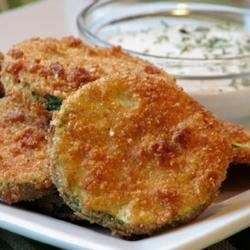 Kelli's Fried Green Zucchini Recipe and Video - Fresh zucchini are sliced and coated with seasoned crumbs, then fried in olive oil, topped with melted mozzarella cheese, and served with spaghetti sauce.