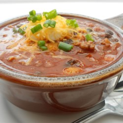 It's Chili by George!! Recipe - This is a good, standard chili, with lots of ground beef, tomatoes, kidney and pinto beans, and onions.  It needs to simmer for 90 minutes on the stove, or can be made in a slow cooker and left to simmer all day.