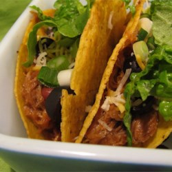 Cowboy Tacos Recipe - It doesn't take very long to whip up a fun meal with this recipe. Cowboys love these meaty tacos with chili beans and olives.