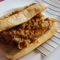 Bourbon-Mango Pulled Pork Recipe and Video - Spicy, smoky, and sweet. This is the perfect addition to that crusty roll you've been trying to figure out a sandwich filling for!