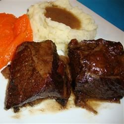 Italian Style Short Ribs Recipe - These delicately seasoned beef short ribs browned in butter, then braised in the oven with beef broth and red wine are delicious served with steamed broccoli and rice.