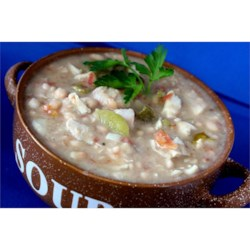 Easy White Chili II Recipe - This slow cooker recipe uses chicken bouillon cubes and navy beans with chicken to make a hearty white chili.