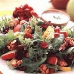 Spinach and Hazelnut Salad with Strawberry Balsamic Vinaigrette Recipe - Spinach and romaine lettuce combine with chopped hazelnuts, juicy golden raisins, red onion, creamy avocado slices, and mini shredded wheat cereal biscuits. The delicious dressing features sugar-free strawberry preserves, aged balsamic vinegar, and extra-virgin olive oil.