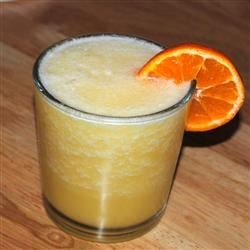 Sex on the Beach I Recipe - A fruity cocktail with a capital FRUIT! Peach schnapps, rum, banana liqueur, orange juice and coconut cream are all blended together with crushed ice.
