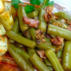 Sweet and Sour Green Beans Recipe - A slightly tart green bean side dish flavored with onion and bacon. Goes great with ham or pork.