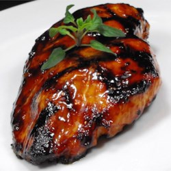 Asian Grilled Chicken Recipe - The flavorful marinade for these grilled chicken thighs is a little sweet, a little salty, and a little tangy, with a hint of spice from Asian chili sauce, curry, and garlic.