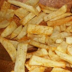 French Fried Potatoes Recipe - These are the best French Fries - the sugar solution has something to do with the carbohydrates, but by doing it they don't soak up so much grease, so they get crunchy.