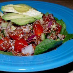 Red Quinoa and Avocado Salad Recipe - A tasty combination of quinoa, avocado, cumin, and lime juice with fresh veggies for a delicious meal!