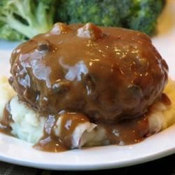Slow Cooker Salisbury Steak Recipe - Ground beef gets a boost of flavor from onion soup mix in this quick and easy slow cooker Salisbury steak recipe.