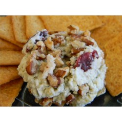 Blue Cheese, Sweet Pecan, and Cranberry Spread Recipe - This cheese spread is made with blue cheese, candied pecans, and cranberries. Serve with crackers or on mini toasts for a colorful and flavorful appetizer.