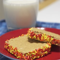 Graham Cracker Icing Recipe - My mother used to make graham cracker cookies for us all the time. We usually just used left-over frosting from a cake. Her recipe was really good, only we usually had chocolate frosting just because that was our favorite. Just leave out cocoa for vanilla frosting.