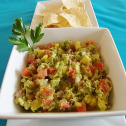 Tropiguac (Hawaiian-style Guacamole) Recipe - Traditional guacamole becomes a Hawaiian-inspired treat with the addition of fresh, sweet mango and pineapple chunks. Diced cucumber imparts an even more refreshing flavor. Mahalo!