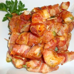 Cheddar Jalapeno Shrimp Recipe - Shrimp are butterflied and stuffed with cheddar and jalapeno, then wrapped in bacon, seasoned and grilled.