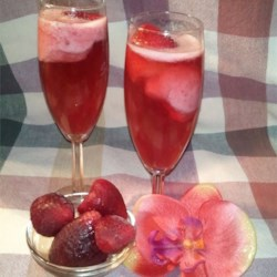 Champagne with Strawberries Recipe - This elegant and easy treat makes a great light ending to any meal. Everyone is impressed and there's nothing to it!