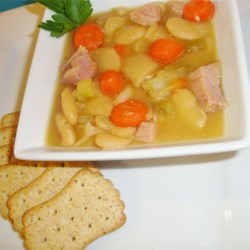 Senate Bean Soup Recipe - Dried Great Northern Beans are cooked with a ham bone, carrots, celery, onions and garlic powder in ham base and water in this recipe to serve 12.