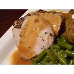 Roasted Loin of Pork with Pan Gravy Recipe - The lean meat of a beautifully roasted pork loin is flavored with a special seasoning mix and served with delicious pan gravy.