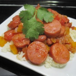 Red Beans and Rice Recipe - Here's a really quick and easy way to enjoy red beans and rice. Hearty slices of smoked sausage round out this dish. Top it with your favorite hot sauce.