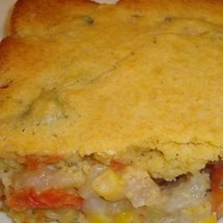 Yummy Turkey Pot Pie Recipe - Turkey pot pie made with leftover turkey meat gets a corn bread topping that's easy because it's made with boxed corn muffin mix.