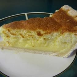 Lemon Sponge Pie I Recipe - This is a baked lemon pie made light and airy with lots of fluffy egg whites folded into the lemony and buttery milk batter. The pie is baked for an hour until the filling is set and the top is golden. Serve with a home made blueberry syrup.