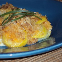 Squash Casserole II Recipe - Yellow squash is baked with milk, butter, eggs and green onions, and topped with cheese and crushed crackers.