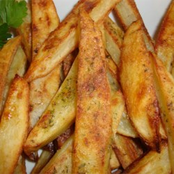 Double Ranch Fries Recipe - These simple French fries are good anytime. Coated with ranch-style seasoning, and deep-fried, they are sure to please even the toughest customers. We like to serve them with ranch dressing and bacon bits.