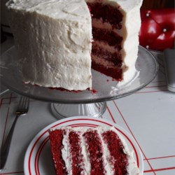Red Velvet Cake I Recipe - Red-tinted chocolate cake is covered with contrasting fluffy frosting for a stunning presentation.