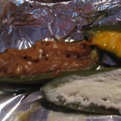Peanut Butter Stuffed Jalapenos Recipe - This is my rendition of the hottest appetizer in Baja. It's a great appetizer that takes the heat out of the peppers. In fact, I had an 80-year-old lady eat one and say, 'Oh my, this is the first time I have been able to eat a whole jalapeno.'