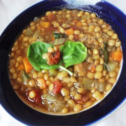 Lentil Soup Recipe and Video - Lentils are coupled with vegetables for this family-friendly lentil soup. Topped with spinach and a splash of vinegar, this is the perfect weekday dinner.