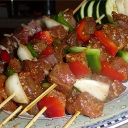 Awesome Spicy Beef Kabobs OR Haitian Voodoo Sticks Recipe - Beef cubes are marinated with cayenne pepper and garlic before being grilled.  This fiery dinner goes great with fresh pitas, chopped onion, and sour cream to temper the black magic heat! Trust me, you'll crave them!