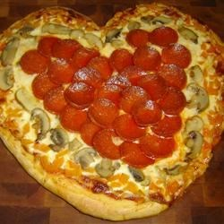 Valentine Pizza Recipe - Make this pizza for your Valentine! The rosemary dough is made in a bread machine, and then made into three heart shaped pizzas.