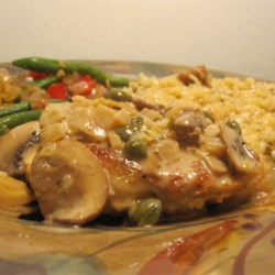 Romantic Chicken with Artichokes and Mushrooms Recipe - Chicken is browned and simmered with marinated artichoke hearts, mushrooms, white wine and capers. A simple, savory aromatic treat.