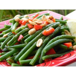 Holiday Green Beans Recipe - Green beans are tossed in butter, lemon, soy and garlic, with pimentos and peanuts, for a nice change from the traditional holiday green bean casserole.