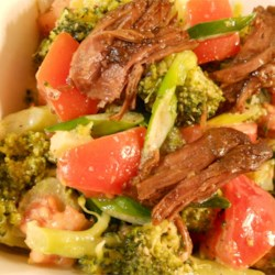 Beef and Broccoli Salad Recipe - This fresh salad pairs cooked roast beef with steamed broccoli florets. cherry tomatoes, and green onions with a zesty mustard-horseradish-sour cream dressing. You can use roast beef from the deli or any kind of leftover steak for the beef.