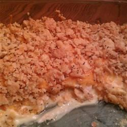 Poppy Seed Chicken Casserole Recipe - Shredded chicken is baked with a creamy poppy seed sauce and topped with a crunchy, melty crust of buttery crackers.