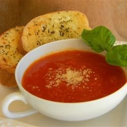 Zesty Tomato Soup for One Recipe - An easy soup to whip up when dining alone. Pamper yourself with a zesty blend of fresh tomato, onion and black pepper. Top with your favorite grated cheese.