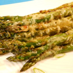 Buck's Italian-Grilled Asparagus Recipe - Asparagus spears are pan-fried with onion and Italian seasonings, then covered with Parmesan cheese for an easy and flavorful side dish.