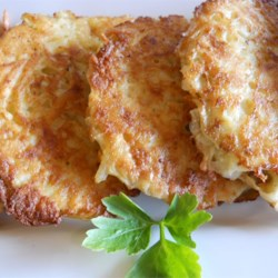 Kay Dee's Recipe for Potato Latkes Recipe - Simple, savory potato latkes with onion take only a few minutes to make, and use simple pantry ingredients.