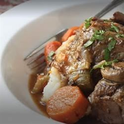 Slow Cooker Beef Pot Roast Recipe - Impossibly tender beef pot roast with carrots, mushrooms and onions. It's easy in the slow cooker. The key is searing the meat first.